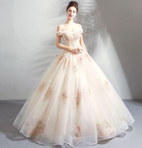 เสื้อผ้าแฟชั่น เสื้อผ้าผู้หญิง ชุดแต่งงานเปิดไหล่สีแชมเปญยาวระบายหรูหรา