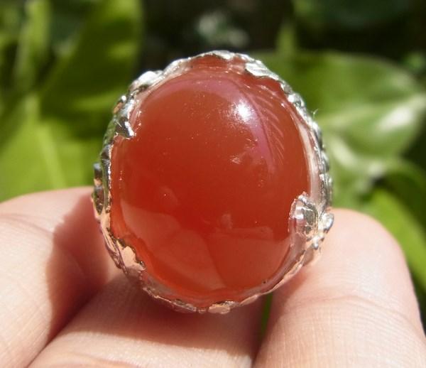 แหวนแก้วโป่งข่ามชนิดแก้ววิทรูย์สุริยะประภาสีแดง เบอร์ 61 ตัวเรือนเงินแท้